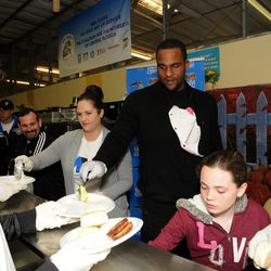 Orlando Magic's Glen Davis serving meals at the Coalition for the Homeless on Thanksgiving morning.  The Magic and Coalition for the Homeless hosted its 20th annual Thanksgiving breakfast for more than 800 men, women and children at the facility.