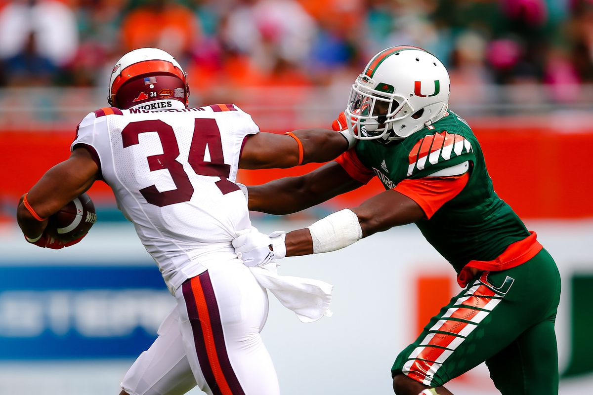 Artie Burns tackles the VT running back on a catch in the flat