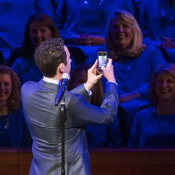 Guest performer Santino Fontana takes a quick selfie before performing with the Tabernacle Choir during the annual Pioneer Day concert Friday, July 18, 2014, in Salt Lake City at the Conference Center.