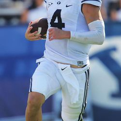 Brigham Young quarterback Taysom Hill (4) runs as BYU and Virginia to play Saturday, Sept. 20, 2014, at LaVell Edwards Stadium in Provo.