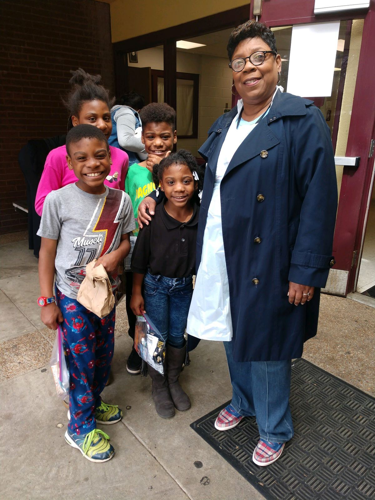 School board member Althea Greene visits a lunch distribution site during the first week.