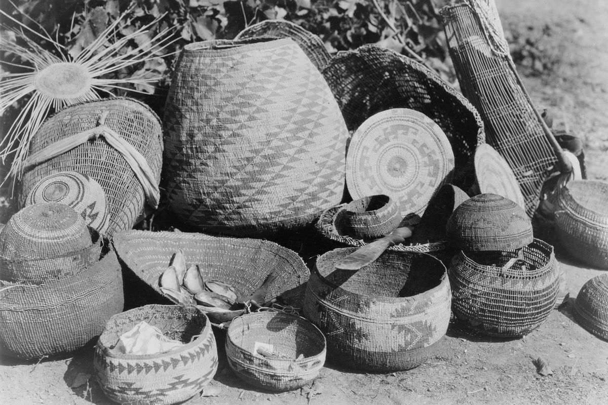 Group Karok baskets some with decorative woven patterns and some with lids, c1923. Native American Indian. Photograph by Edward Curtis (1868-1952). ...