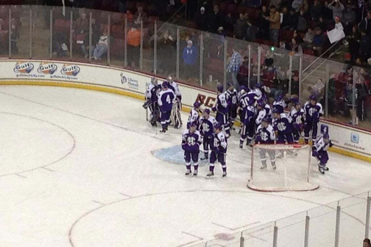 Holy Cross players celebrate an upset of Boston College in November.