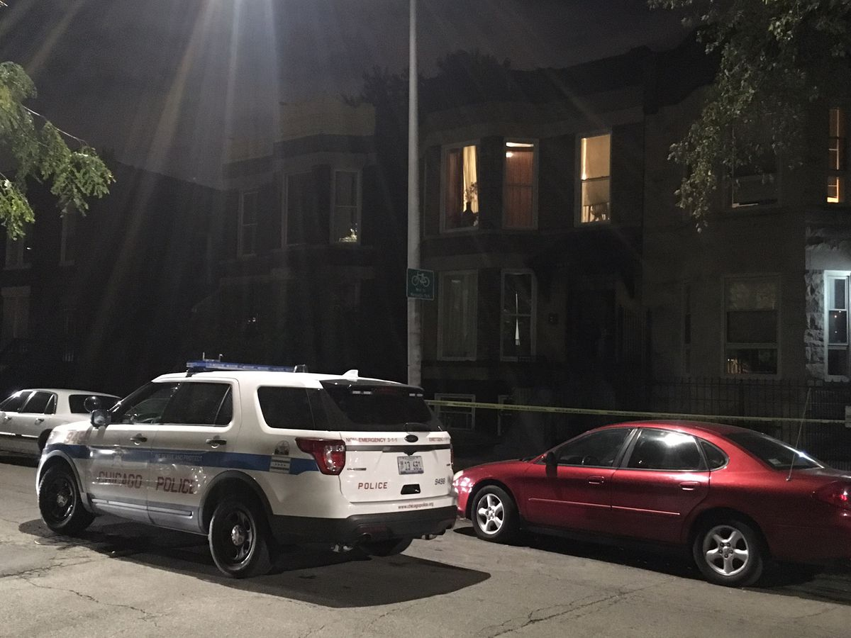 A police car is seen in the 6600 block of South Marquette on Sunday evening, where a 16-year-old girl was accidentally shot to death by an acquaintance, Chicago Police said. | Jon Seidel/Chicago Sun-Times