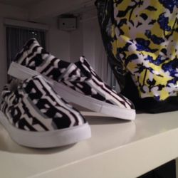 Close-up on one style of the printed slip-on sneakers.