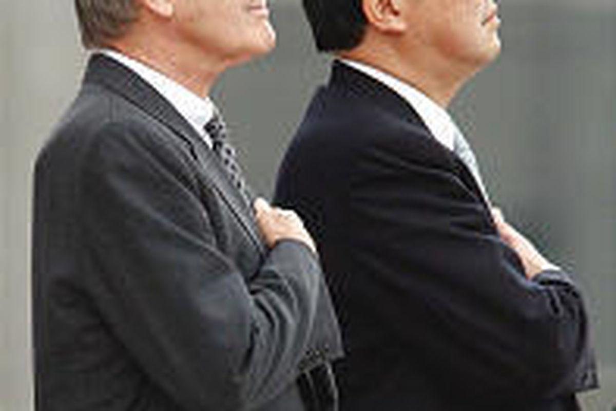 Defense Secretary Donald H. Rumsfeld, left, and his Japanese counterpart, Shigeru Ishiba, attend the guard of honor.