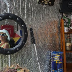 This April 20, 2012, photo shows a reflection of businesswoman Julia Hutton, who recently launched the Man Cave, a trailer that will offer shoe shines, hair cuts and retail geared toward the men in Ahwatukee, Ariz. Hutton now runs four mobile retail shops through her new venture, ExTreme ReTrailers, LLC.