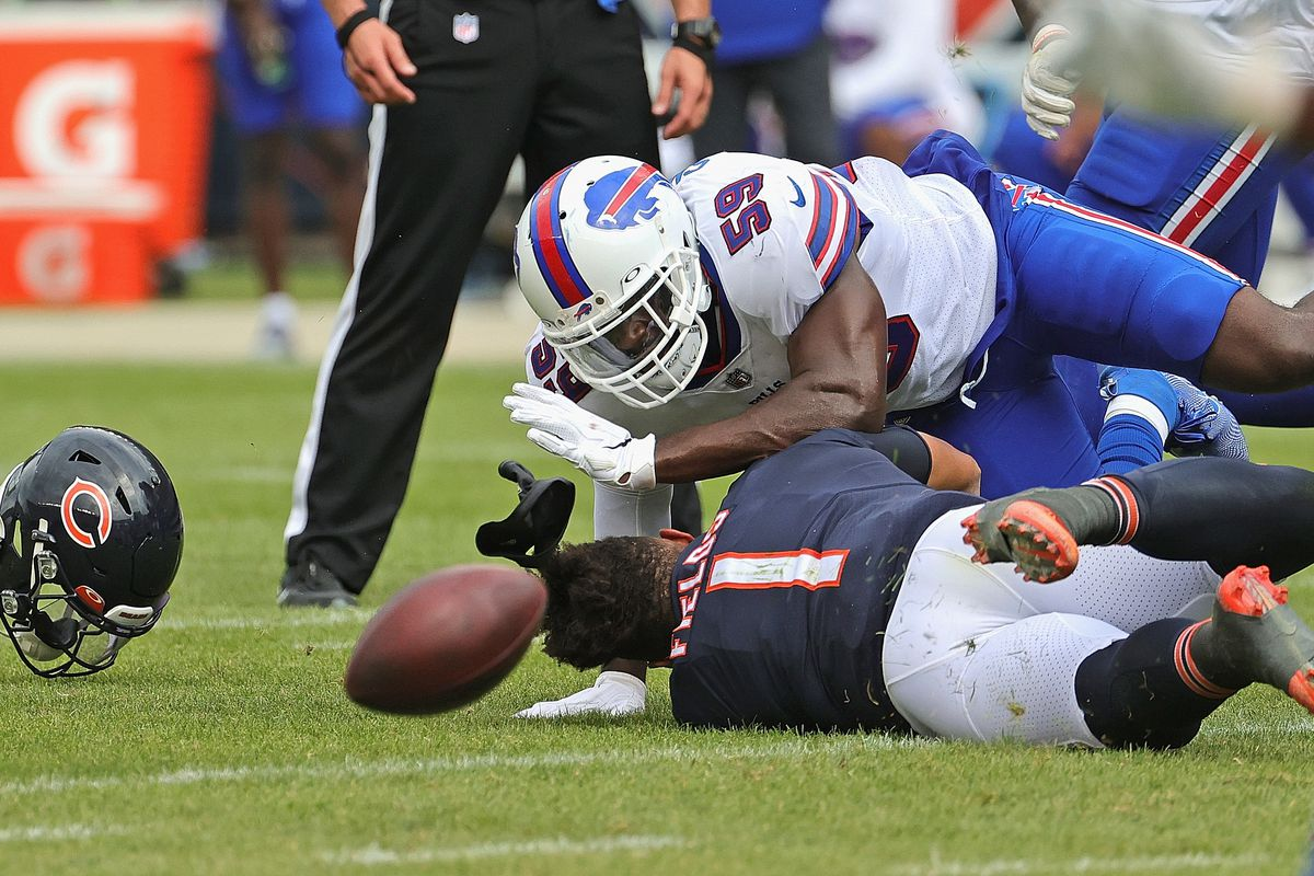 Bears quarterback Justin Fields is hit by the Bills' Andre Smith in a preseason game Saturday at Soldier Field.