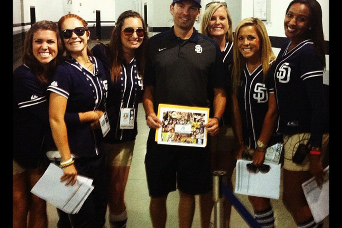 Here's Padres Clubhouse Attendant James being showered with attention by the Pad Squad.  All is right with the world.