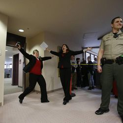 Becky Dustin, left, and Jennifer Rasmussen, right, exit the Salt Lake County clerk's office with a marriage license, Monday, Dec. 23, 2013.