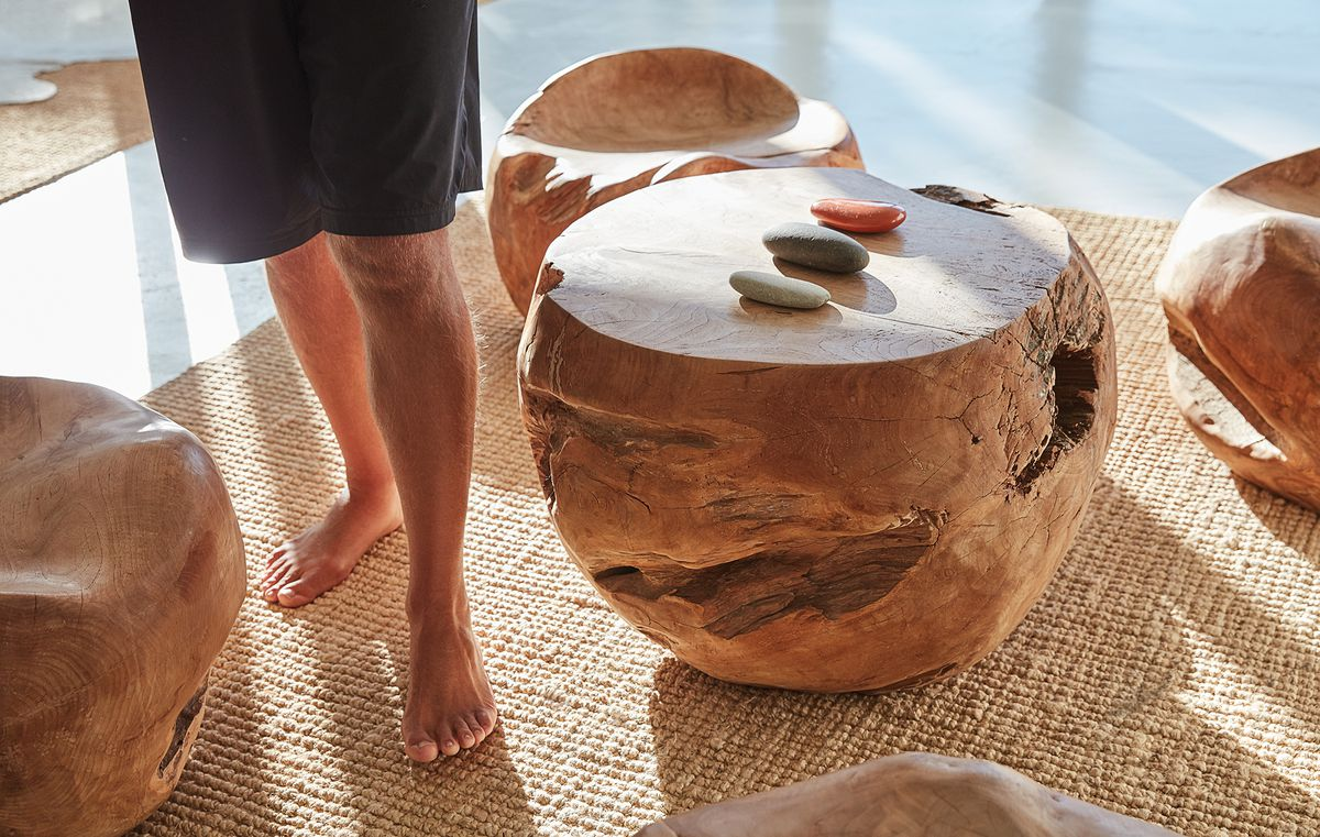 Rubin's feet amid wood sculptures