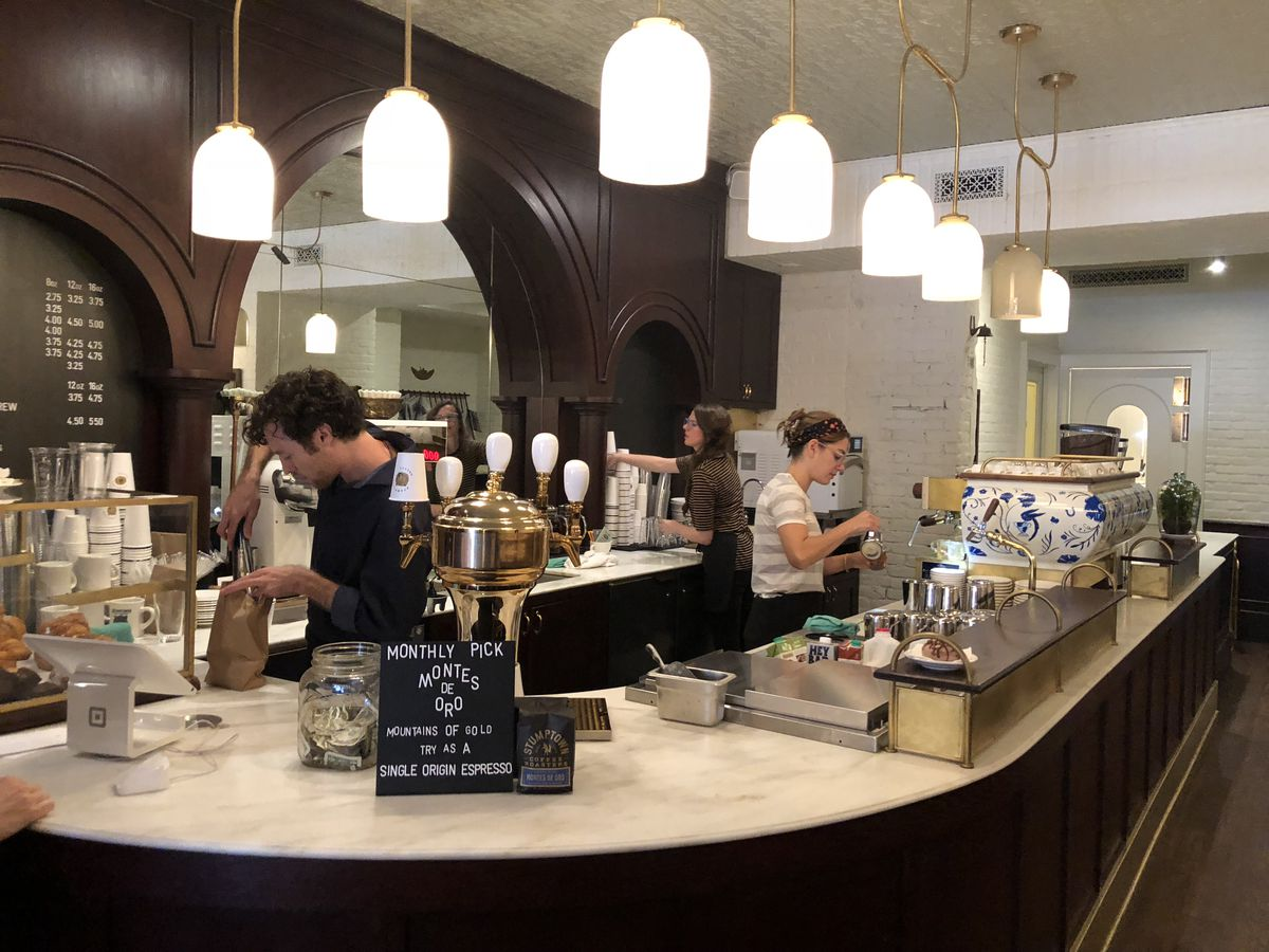 Baristas working behind the counter at Stumptown