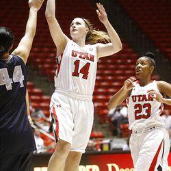 Utah's Paige Crozon puts up a shot over Utah State's Franny Caaulu as Utah and Utah State play , in the Huntsman Center. Utah won 92-64.