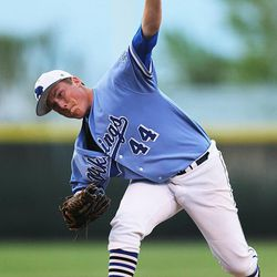 Pleasant Grove's Brody Blackhurst makes a pitch as Bingham and Pleasant Grove play Wednesday, May 21, 2014 in a 5A one-loss bracket game at Kearns.