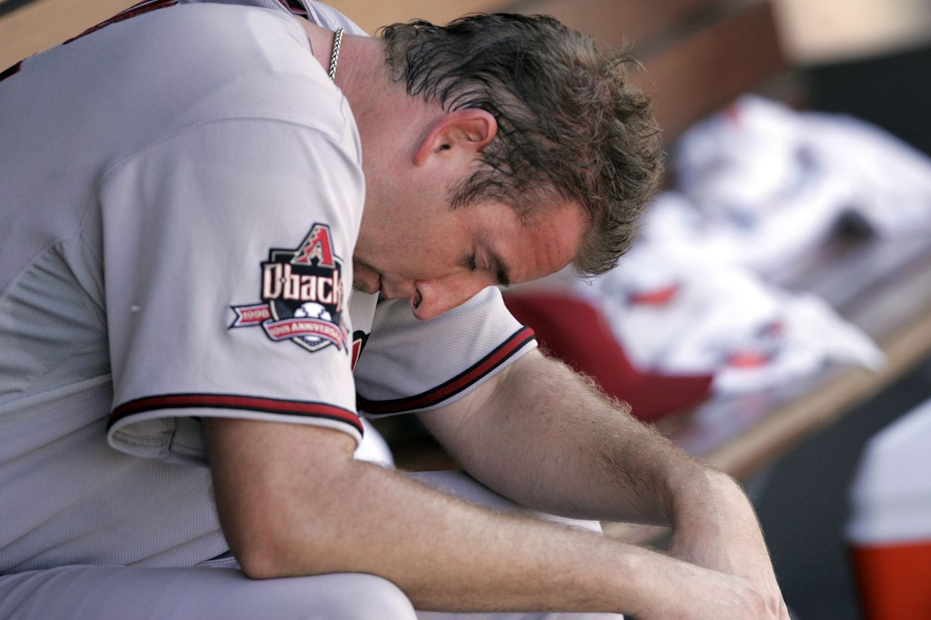 Arizona Diamondbacks Brandon Webb, unable to get his 20th win, sits in the dugout after being taken