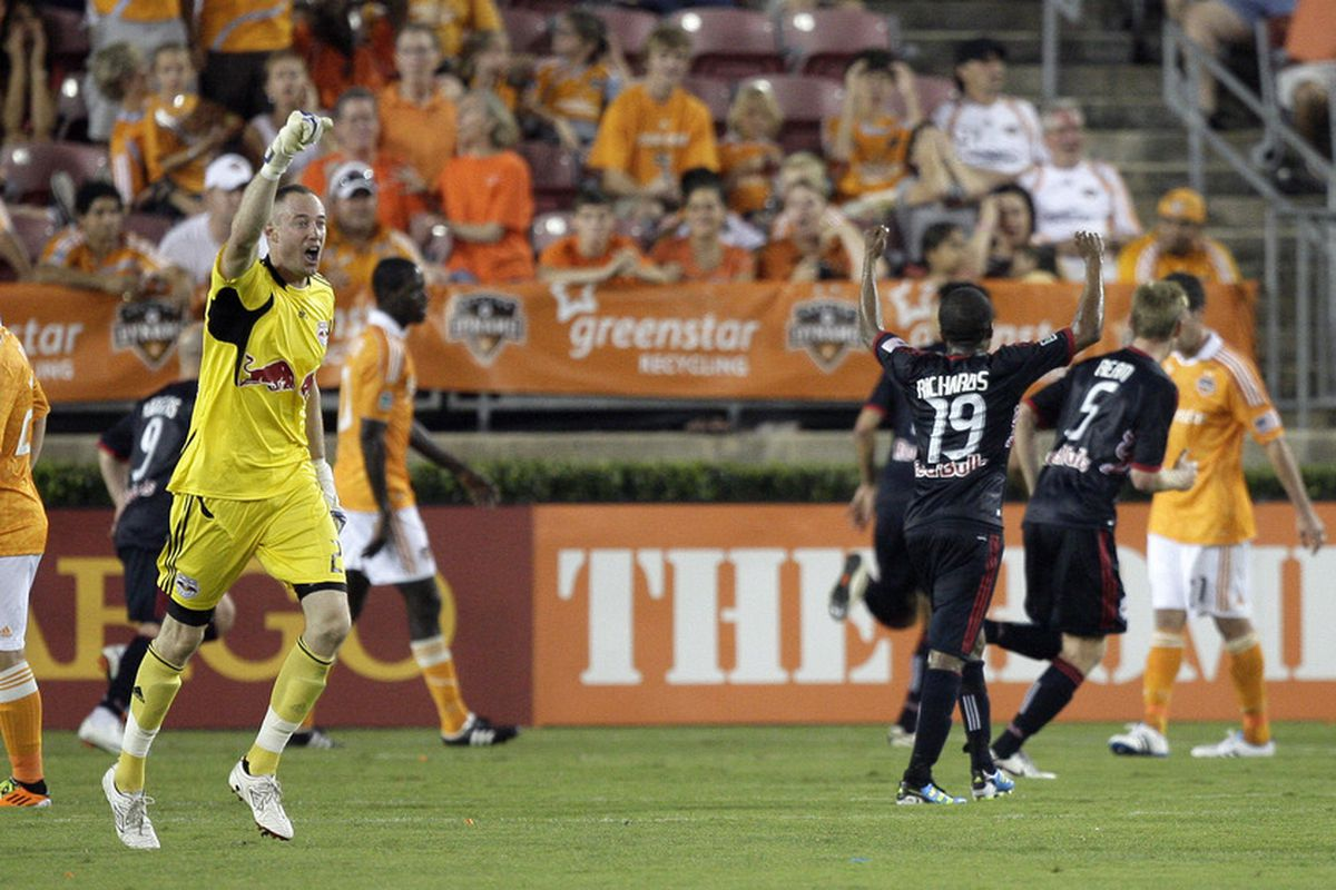 HOUSTON - MAY 21: Goalkeeper Greg Sutton #24 of the New York Red Bulls pumps his fist after Mehdi Ballouchy #10 scored the tieing goal in extra time at Robertson Stadium on May 21, 2011 in Houston, Texas. (Photo by Bob Levey/Getty Images)