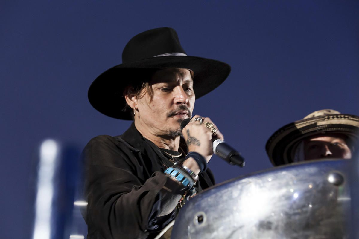 Actor Johnny Depp addresses film goers at the Glastonbury music festival at Worthy Farm, in Somerset, England, Thursday, June 22, 2017. (Photo by Grant Pollard/Invision/AP)