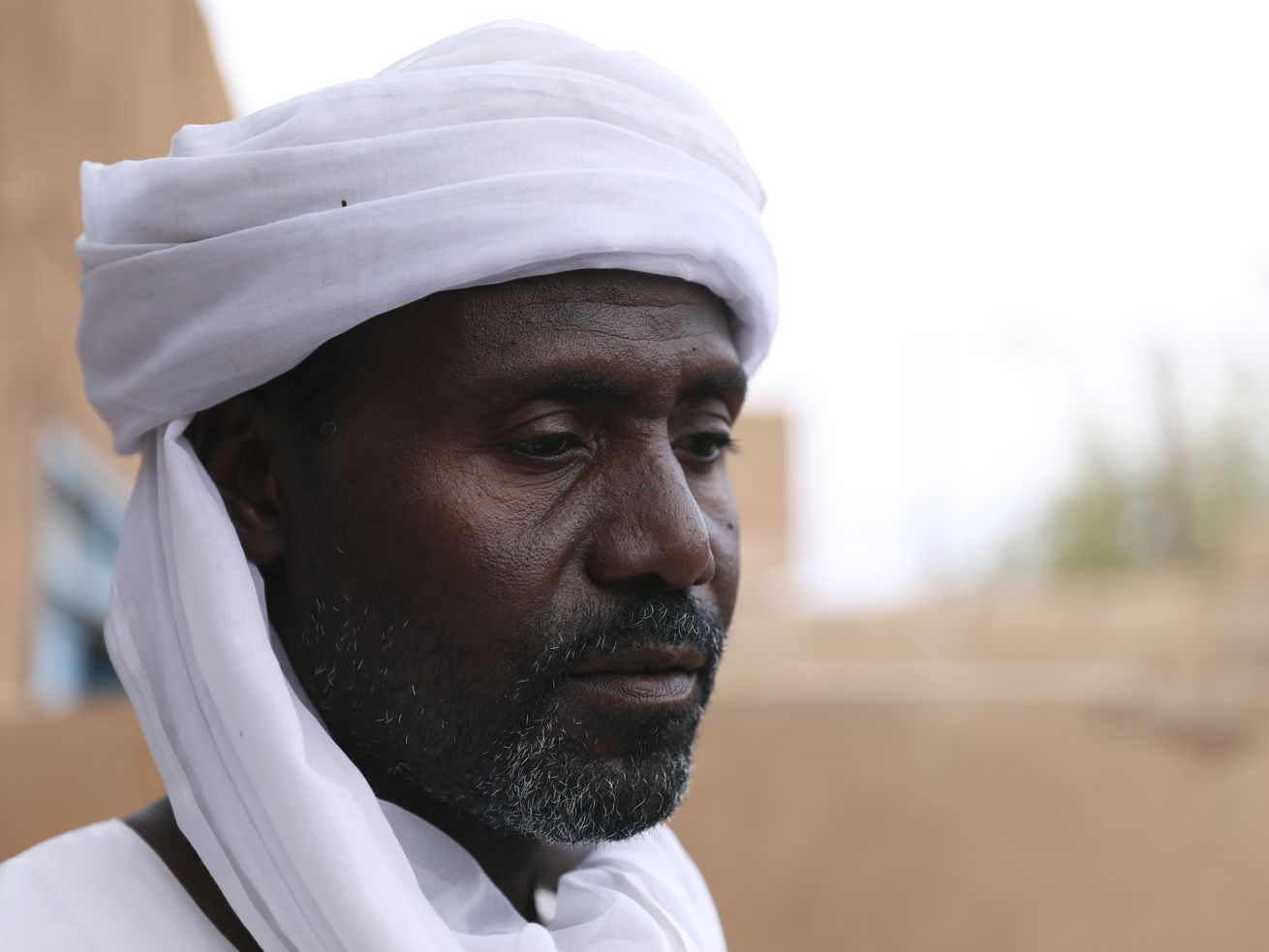 Abdullah Jaber, whose son Mubarak died in a migrant ship sinking last month, sits at his home in Khartoum, Sudan, Friday, April 30 2021.