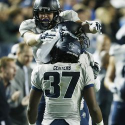 Utah State Aggies safety Devin Centers (37) celebrates his interception against Brigham Young Cougars in Provo Saturday, Oct. 4, 2014. USU won 35-20.