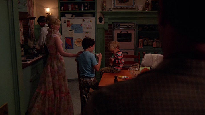 Don watches his ex-wife and sons, in a life that could have been his, on Mad Men.