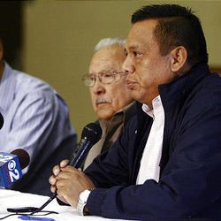 From right, Tony Yapias, Archie Archleta and Mark Alvarez react in favor of the Utah Compact during a press conference at the Centro Civico Mexicano in Salt Lake City Friday, November 12, 2010.  The Utah Compact was signed Thursday in favor of federal immigration reform