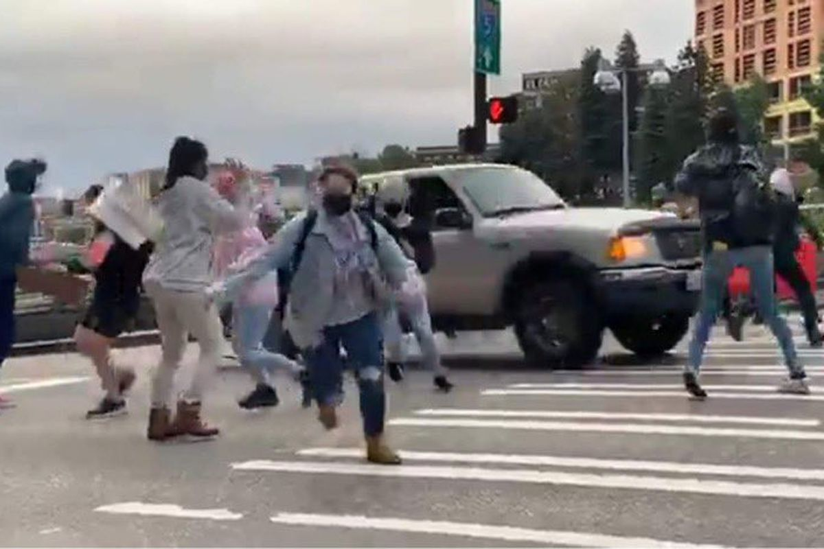 In this video screengrab, a truck speeds through an intersection where protesters were gathered on Capitol Hill Tuesday night.