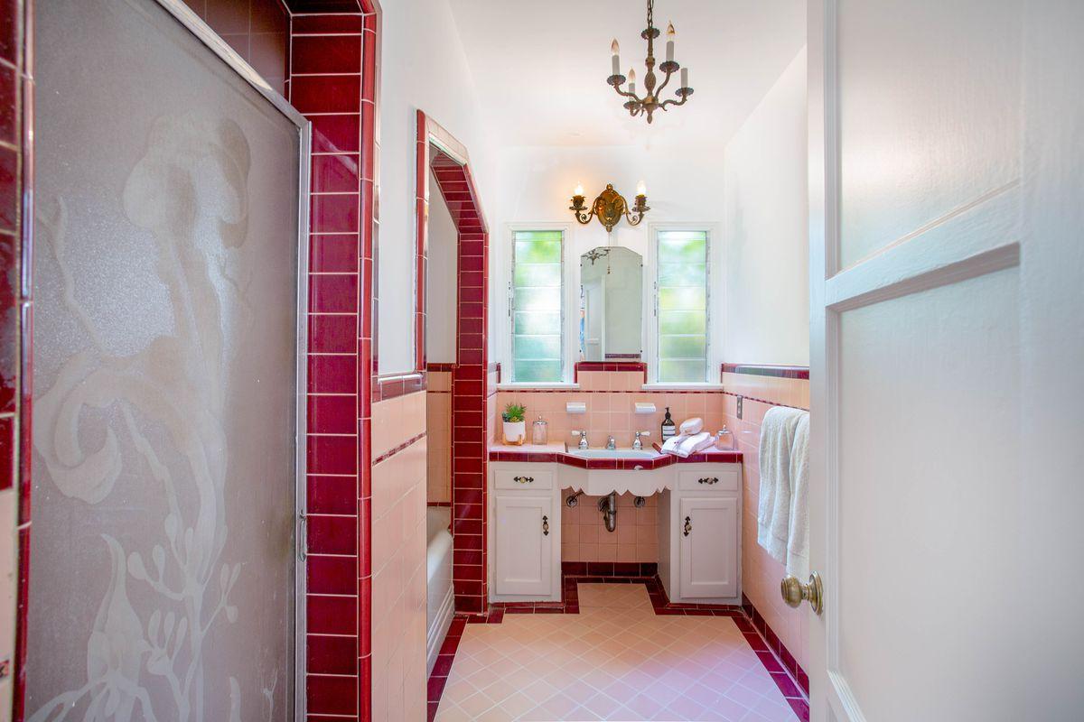 Pink tiles in a bathroom.