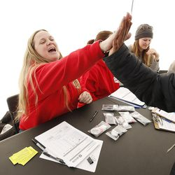 Mindy Vincent high-fives a client after handing out syringes during an exchange program in Salt Lake City on Thursday, Dec. 29, 2016. Vincent is a former drug addict who is now clean. After she lost a sister to an overdose, she decided to start Utah's first syringe exchange program.
