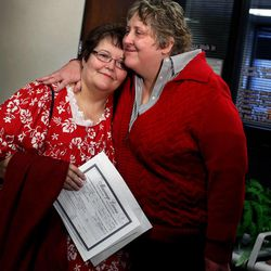 Shelly Eyre, left, and Cheryl Haws hug after receiving a marriage license from the Utah County Clerk's Office in Provo on Thursday, Dec. 26, 2013. Eyre and Haws served the Utah County Clerk's Office with a lawsuit Monday after the clerk's office refused to grant them a marriage license.