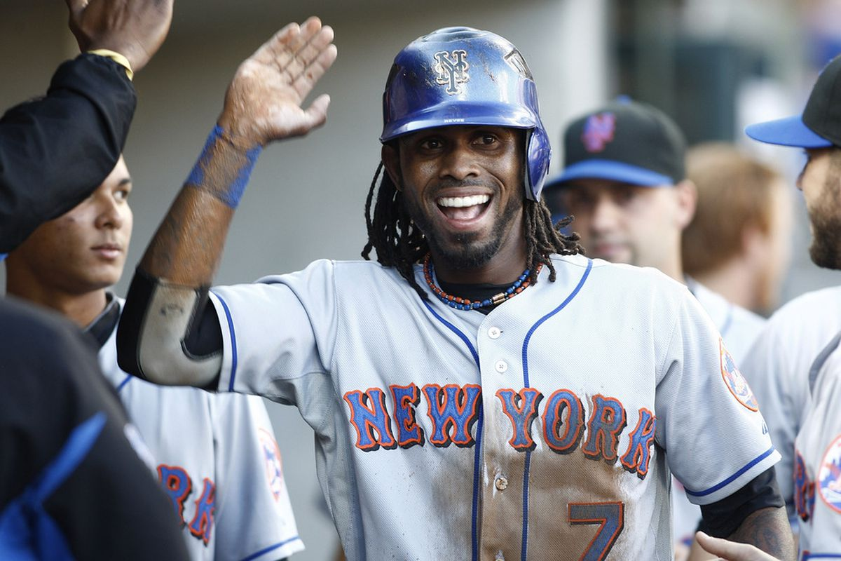 DETROIT, MI - JUNE 29:  Jose Reyes #7 of the New York Mets is congratulated after scoring the first run of the game against the Detroit Tigers on June 29, 2011 at Comerica Park in Detroit, Michigan.  (Photo by John Grieshop/Getty Images)