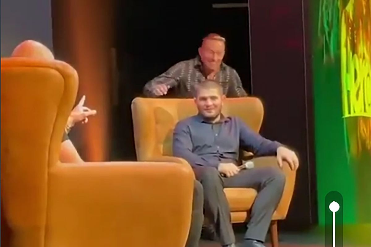 Georges St-Pierre sneaks up on Khabib Nurmagomedov at an event in the UK.