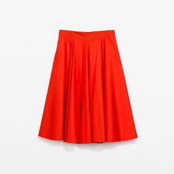 <b>Outdoor City Outfit:</b> Kohn says bright colors show up well in city portraits. He likes red, but anything with high contrast with photograph well in an urban setting. This bright top and skirt combo from Zara looks put together and doesn't show too m