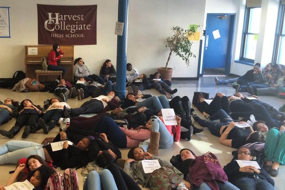 Students at Harvest Collegiate High School stage a demonstration at the school to protest the indictment decision over Eric Garner's death.