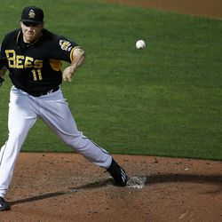 Salt Lake Bees pitcher Greg Mahle (11) throws to first base during a game against the Las Vegas 51s at Smith's Ballpark in Salt Lake City on Monday, June 5, 2017.