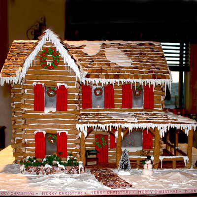 Gingerbread cabin with red door and windows.