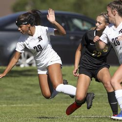 Annie Haycock, of Davis, center, trips Northridge's Molly Mcreaken during soccer game in Kaysville on Tuesday, Aug. 20, 2019. Northridge defeated Davis 1-0.