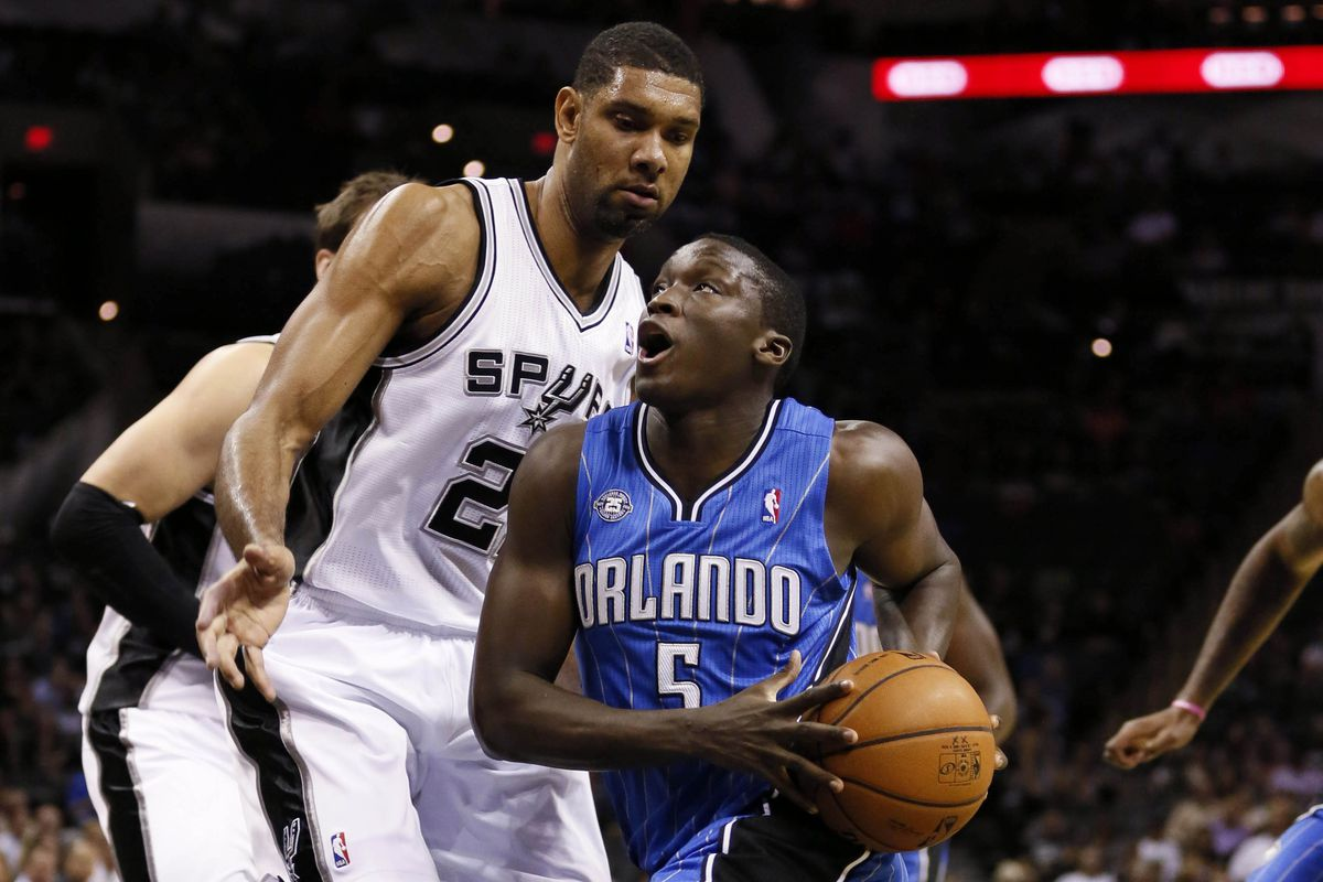 Tim Duncan and Victor Oladipo