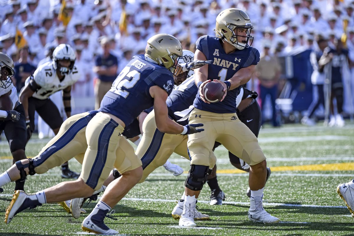 Navy Midshipmen quarterback Tai Lavatai hands the ball off to fullback Isaac Ruoss during the University of Central Florida game versus the Navy on October 2, 2021 at Navy - Marine Corps Memorial Stadium in Annapolis, MD.