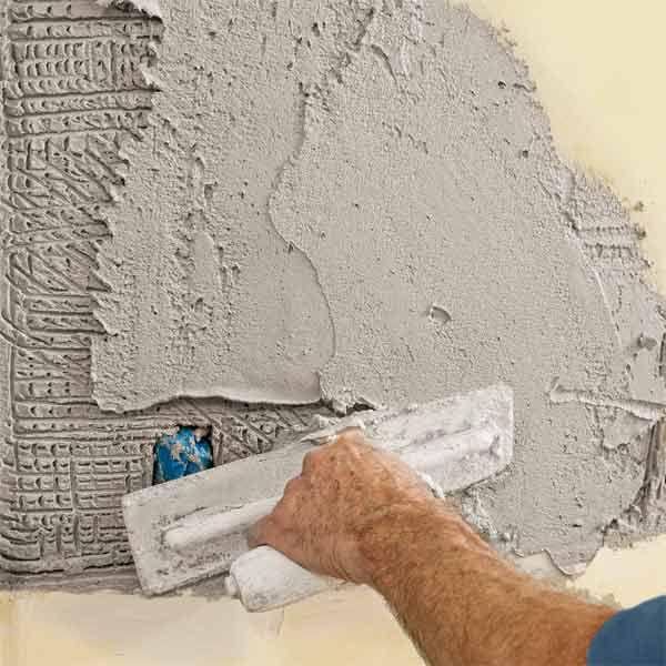 Trowel on second coat of plaster.