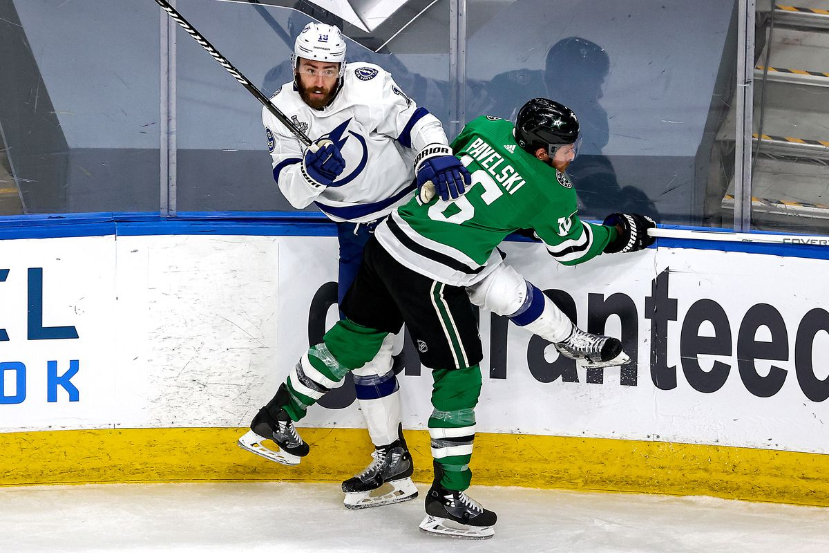 Barclay Goodrow #19 of the Tampa Bay Lightning is checked into the boards by Joe Pavelski #16 of the Dallas Stars during the second period in Game Three of the 2020 NHL Stanley Cup Final at Rogers Place on September 23, 2020 in Edmonton, Alberta, Canada.