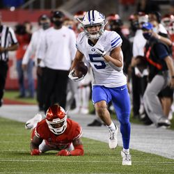 BYU wide receiver Dax Milne, right, runs for a touchdown while Houston cornerback Shaun Lewis, left, watches during the first half of an NCAA college football game on Friday, October 16, 2020 in Houston.