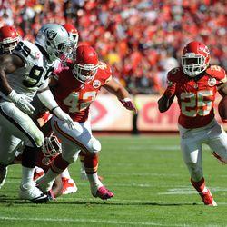 Kansas City Chiefs running back Jamaal Charles (25) runs the ball as Oakland Raiders linebacker Kaelin Burnett (95) attempts the tackle during the second half at Arrowhead Stadium. The Chiefs won 24-7.
