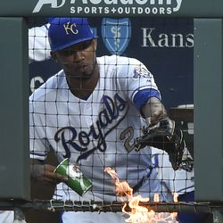 Alcides Escobar tries to put out a fire in the dugout before a game against the Twins in September.
