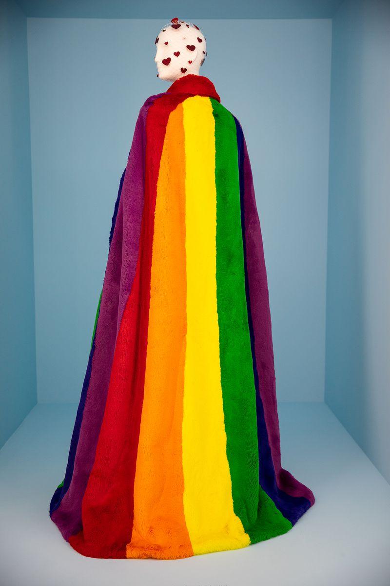 A furry rainbow cape.