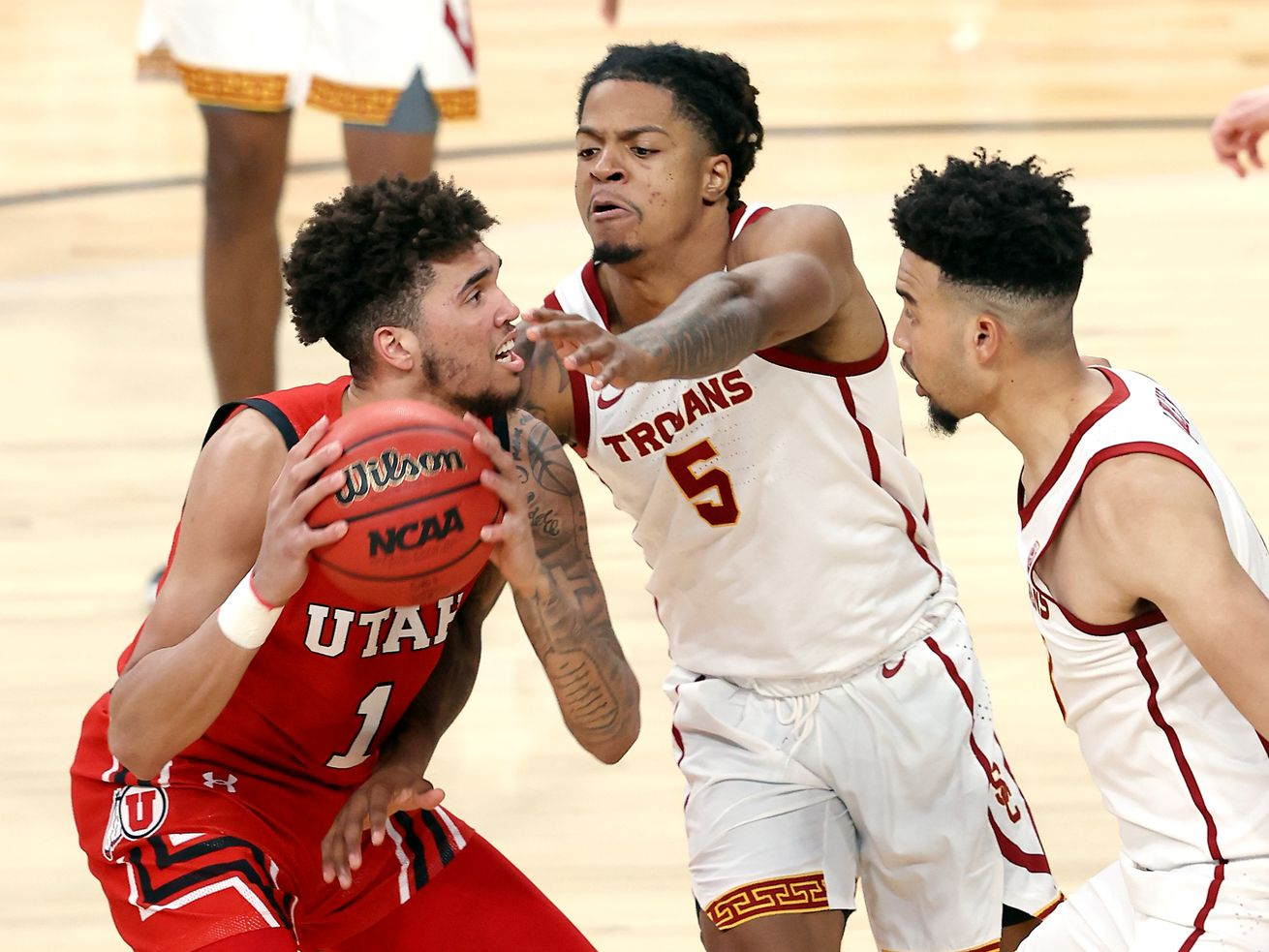 Utah Utes forward Timmy Allen (1) works to get off a shot with USC Trojans guard Isaiah White (5) defending him as Utah and USC play in the Pac-12 Tournament at T-Mobile Arena in Las Vegas on Thursday, March 11, 2021. USC won 91-85 in double overtime.