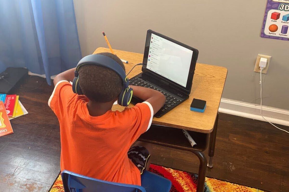 First grader Billy Onley does classwork at his desk at home as part of virtual learning in Shelby County Schools. His mother, Arionna Onley, has started a petition that requests that the virtual school day be shortened from seven hours a day.