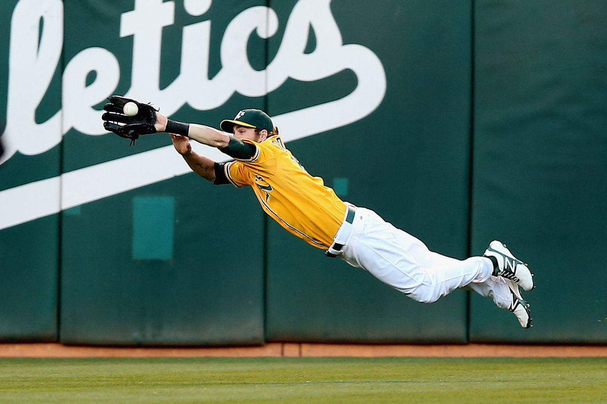 OAKLAND, CA - JULY 07:  Josh Reddick #16 of the Oakland Athletics dives to catch a ball hit by Ichiro Suzuki #51 of the Seattle Mariners in the third inning at O.co Coliseum on July 7, 2012 in Oakland, California.  (Photo by Ezra Shaw/Getty Images)