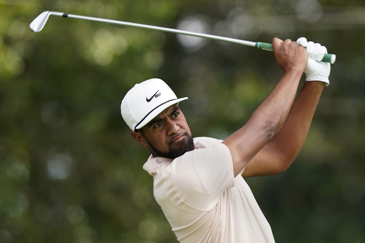 Tony Finau hits from the tee on the second hole during second-round play in the Tour Championship golf tournament