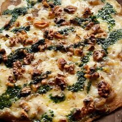 Cheese Bar's two-cheese pizza with walnuts and arugula emulsion.