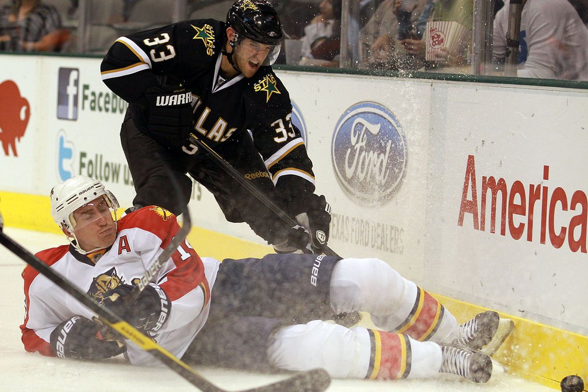 DALLAS, TX - SEPTEMBER 29:  Tomas Fleischmann #14 of the Florida Panthers falls in front of Alex Goligoski #33 of the Dallas Stars at American Airlines Center on September 29, 2011 in Dallas, Texas.  (Photo by Ronald Martinez/Getty Images)